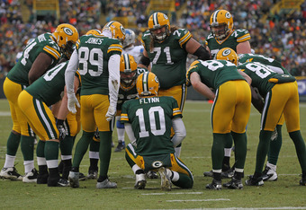 GREEN BAY, WI - JANUARY 01:  Matt Flynn #10 of the Green Bay Packers calls a play in the huddle against the Detroit Lions at Lambeau Field on January 1, 2012 in Green Bay, Wisconsin. The Packers defeated the Lions 45-41.  (Photo by Jonathan Daniel/Getty I