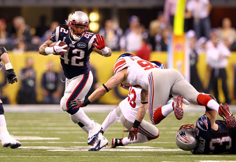 INDIANAPOLIS, IN - FEBRUARY 05:  BenJarvus Green-Ellis #42 of the New England Patriots runs the ball agains Chase Blackburn #93 of the New York Giants during Super Bowl XLVI at Lucas Oil Stadium on February 5, 2012 in Indianapolis, Indiana.  (Photo by Al