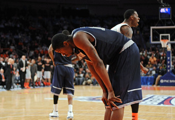 NEW YORK, NY - MARCH 08:  Henry Sims #14 of the Georgetown Hoyas reacts after turning the ball over late in the game against the Cincinnati Bearcats during the quarterfinals of the Big East Men's Basketball Tournament at Madison Square Garden on March 8,