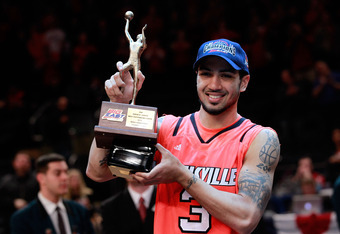 NEW YORK, NY - MARCH 10:  Peyton Siva #3 of the Louisville Cardinals holds up his MVP trophy after defeating the Cincinnati Bearcats during the finals of the Big East Men's Basketball Tournament at Madison Square Garden at Madison Square Garden on March 1