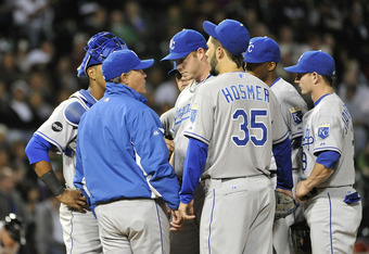 CHICAGO, IL - SEPTEMBER 23:  Manager Ned Yost #3 of the Kansas City Royals (C) talks to relief pitcher Blake Wood #38 as the rest of the team gather on the mound during the eighth inning against the Chicago White Sox at U. S. Cellular Field on September 2