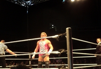 Ziggler prepares for the broomstick match. Roberts is laughing.