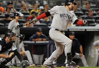 NEW YORK, NY - SEPTEMBER 25: Adrian Gonzalez #28 of the Boston Red Sox grounds into an RBI fielders choice during the top of the sixth inning against the New York Yankees on September 25, 2011 at Yankee Stadium in the Bronx borough of New York City. (Phot
