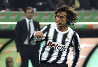MILAN, ITALY - FEBRUARY 25:  Andrea Pirlo of Juventus runs with the ball during the Serie A match between AC Milan and Juventus FC at Stadio Giuseppe Meazza on February 25, 2012 in Milan, Italy.  (Photo by Dino Panato/Getty Images)