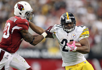 GLENDALE, AZ - OCTOBER 23:  Runningback Mewelde Moore #21 of the Pittsburgh Steelers rushes the football against A.J. Jefferson #20 of the Arizona Cardinals during the NFL game at the University of Phoenix Stadium on October 23, 2011 in Glendale, Arizona.