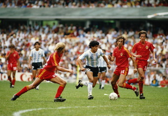 Patrick Vervoort of Belgium closes in on Diego Maradona of Argentina as Stefan Demol (21) of Belgium looks on during the 1986 FIFA World Cup Semi Final on 25 June 1986 at the Azteca Stadium in Mexico City, Mexico. Argentina defeated Belgium 2-0. (Photo by