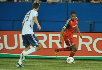 TORONTO, CANADA - MARCH 7:  Ryan Johnson #9 of the Toronto FC looks to pass the ball as Andrew Boyens #29 of the Los Angeles Galaxy defends during CONCACAF Champions League game action March 7, 2012 at the Rogers Centre in Toronto, Canada (Photo by Brad W