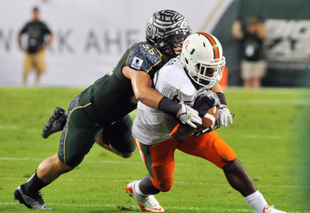 TAMPA, FL - NOVEMBER 19:  Running back Lama Miller #6 of the Miami Hurricanes runs upfield against the South Florida Bulls November 19, 2011 at Raymond James Stadium in Tampa, Florida.  Miami won 6 - 3. (Photo by Al Messerschmidt/Getty Images)