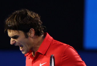 MELBOURNE, AUSTRALIA - JANUARY 26:  Roger Federer of Switzerland celebrates a point in his semifinal match against Rafael Nadal of Spain during day eleven of the 2012 Australian Open at Melbourne Park on January 26, 2012 in Melbourne, Australia.  (Photo b