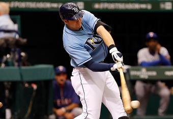 ST. PETERSBURG - OCTOBER 04:  Infielder Evan Longoria #3 of the Tampa Bay Rays flies out against the Texas Rangers during Game Four of the American League Division Series at Tropicana Field on October 4, 2011 in St. Petersburg, Florida.  (Photo by J. Meri