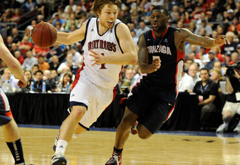 LAS VEGAS, NV - MARCH 05:  Matthew Dellavedova #4 of the Saint Mary's Gaels drives against Gary Bell Jr. #5 of the Gonzaga Bulldogs during the championship game of the Zappos.com West Coast Conference Basketball tournament at the Orleans Arena March 5, 20