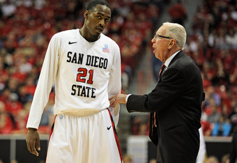 LAS VEGAS, NV - MARCH 09:  Jamaal Franklin #21 of the San Diego State Aztecs talks with head coach Steve Fisher during a semifinal game of the Conoco Mountain West Conference Basketball tournament against the Colorado State Rams at the Thomas & Mack Cente