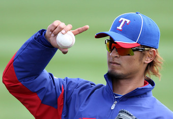 PEORIA, AZ - MARCH 07:  Starting pitcher Yu Darvish #11 of the Texas Rangers warms up before the spring training game against the San Diego Padres at Peoria Stadium on March 7, 2012 in Peoria, Arizona.  (Photo by Christian Petersen/Getty Images)