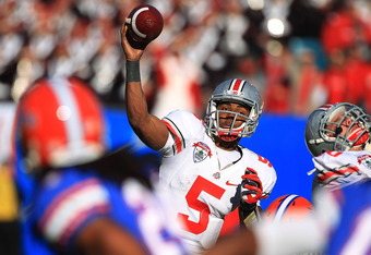 JACKSONVILLE, FL - JANUARY 02:  Quarterback Braxton Miller #5 of Ohio State Buckeyes throws a pass during the first half at the TaxSlayer.com Gator Bowl against the Florida Gators at EverBank Field on January 2, 2012 in Jacksonville, Florida.  (Photo by S