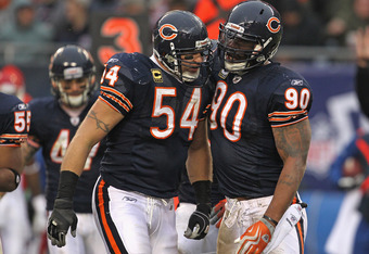 CHICAGO, IL - DECEMBER 04: Brian Urlacher #54 and Julius Peppers #90 of the Chicago Bears celebrate a defensive stop against the Kansas City Chiefs at Soldier Field on December 4, 2011 in Chicago, Illinois. The Chiefs defeated the Bears 10-3. (Photo by Jo