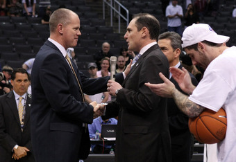 LOS ANGELES, CA - MARCH 10:  Head coach Tad Boyle shakes hands with Pac-12 commissioner Larry Scott after the Buffaloes 53-51 victory against the Arizona Wildcats in the championship game of the Pacific Life Pac-12 basketball tournament at Staples Center