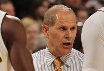 INDIANAPOLIS, IN - MARCH 09: Head coach John Beilein of the Michigan Wolverines gives instructions to his team including Tim Hardaway Jr. #10 and Jordan Morgan #52 against the Minnesota Golden Gophers during the Big Ten Basketball Tournament Quarterfinals