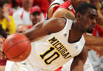 INDIANAPOLIS, IN - MARCH 10:  Tim Hardaway Jr. #10 of the Michigan Wolverines drives against the Ohio State Buckeyes during their Semifinal game of the 2012 Big Ten Men's Basketball Conference Tournament at Bankers Life Fieldhouse on March 10, 2012 in Ind