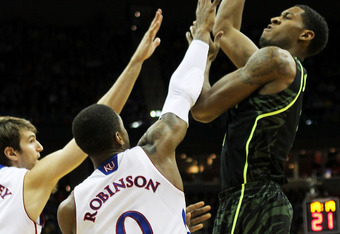 KANSAS CITY, MO - MARCH 09:  Perry Jones III #1 of the Baylor Bears shoots over Thomas Robinson #0 and Justin Wesley #4 of the Kansas Jayhawks in the first half during the semifinals of the 2012 Big 12 Men's Basketball Tournament at Sprint Center on March