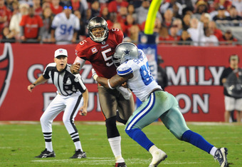 TAMPA, FL - DECEMBER 17:  Linebacker Anthony Spencer #93 of the Dallas Cowboys pressures quarterback Josh Freeman #5 of the Tampa Bay Buccaneers December 17, 2011 at Raymond James Stadium in Tampa, Florida. (Photo by Al Messerschmidt/Getty Images)
