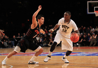 NEW YORK, NY - DECEMBER 10: Ashton Gibbs #12 of the Pittsburgh Panthers dribbles past Cezar Guerrero #1 of the Oklahoma State Cowboys at Madison Square Garden on December 10, 2011 in New York City.  (Photo by Chris Trotman/Getty Images)