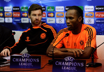 NAPLES, ITALY - FEBRUARY 20:   Striker Didier Drogba (R) and Andre Villas-Boas (L) the Chelsea manager speak to the media during the Chelsea press conference ahead of the UEFA Champions League round of sixteen, first leg match between Napoli and Chelsea F