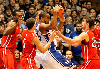 DURHAM, NC - NOVEMBER 18:  Josh Hairston #15 of the Duke Blue Devils is surrounded by the defense of the Davidson Wildcats during their game at Cameron Indoor Stadium on November 18, 2011 in Durham, North Carolina.  (Photo by Streeter Lecka/Getty Images)