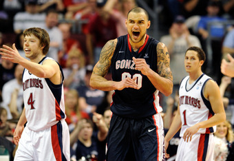 LAS VEGAS, NV - MARCH 05:  Robert Sacre #00 of the Gonzaga Bulldogs reacts in front of Matthew Dellavedova #4 and Jorden Page #1 of the Saint Mary's Gaels after getting a foul call during the championship game of the Zappos.com West Coast Conference Baske