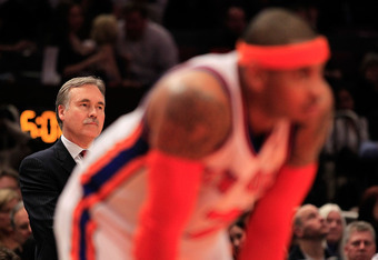 NEW YORK, NY - MARCH 30: Head coach Mike D'Antoni looks on over his player Carmelo Anthony #7 of the New York Knicks during the game against the New Jersey Nets at Madison Square Garden on March 30, 2011 in New York City. NOTE TO USER: User expressly ackn
