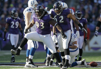 BALTIMORE, MD - DECEMBER 11: Cory Redding #93 and Terrence Cody #62 of the Baltimore Ravens celebrate a defensive play against the Indianapolis Colts during the first half against the Indianapolis Colts at M&T Bank Stadium on December 11, 2011 in Baltimor