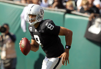 OAKLAND, CA - OCTOBER 16:  Jason Campbell #8 of the Oakland Raiders runs with the ball against the Cleveland Browns at O.co Coliseum on October 16, 2011 in Oakland, California.  (Photo by Ezra Shaw/Getty Images)
