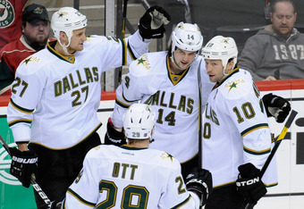 ST PAUL, MN - MARCH 13: Adam Pardy #27, Steve Ott #29 and Brenden Morrow #10 of the Dallas Stars congratulate Jamie Benn #14 on a goal during the third period on March 13, 2012 at Xcel Energy Center in St Paul, Minnesota. The Stars defeated the Wild 1-0.