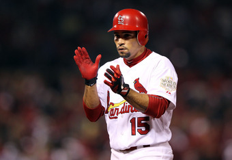 ST LOUIS, MO - OCTOBER 28:  Rafael Furcal #15 of the St. Louis Cardinals celebrates after hitting a single in the second inning during Game Seven of the MLB World Series against the Texas Rangers at Busch Stadium on October 28, 2011 in St Louis, Missouri.