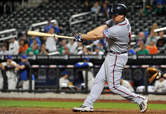 NEW YORK, NY - SEPTEMBER 08: Chipper Jones #10 of the Atlanta Braves connects for an RBI double in the top of the ninth inning against the New York Mets at Citi Field on September 8, 2011 in the Flushing neighborhood of the Queens borough of New York City