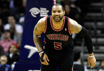 CHARLOTTE, NC - FEBRUARY 10:  Carlos Boozer #5 of the Chicago Bulls reacts to a basket against the Charlotte Bobcats during their game at Time Warner Cable Arena on February 10, 2012 in Charlotte, North Carolina. NOTE TO USER: User expressly acknowledges