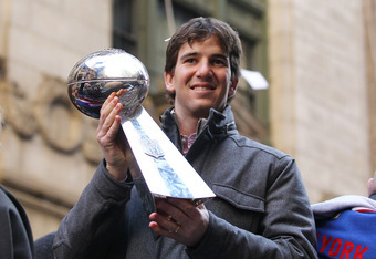 NEW YORK, NY - FEBRUARY 07:  Eli Manning #10 of the New York Giants holds the Vince Lombardi Trophy during the New York Giants' ticker tape victory parade down the Canyon of Heros on February 7, 2012 in New York City.  The Giants defeated the New England