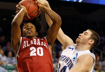 GREENSBORO, NC - MARCH 16:  Levi Randolph #20 of the Alabama Crimson Tide goes to the hoop against Ethan Wragge #34 of the Creighton Bluejays during the second round of the 2012 NCAA Men's Basketball Tournament at Greensboro Coliseum on March 16, 2012 in