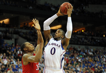 OMAHA, NE - MARCH 16:  Thomas Robinson #0 of the Kansas Jayhawks drives inside in the second half against Eli Holman #32 of the Detroit Titans during the second round of the 2012 NCAA Men's Basketball Tournament at CenturyLink Center on March 16, 2012 in