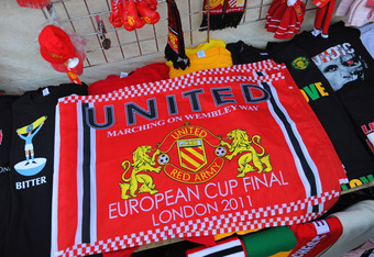 MANCHESTER, ENGLAND - MAY 04:  A flag celebrating Manchester United progressing to the Final of the Champions League for sale ahead of the UEFA Champions League Semi Final second leg at Old Trafford on May 4, 2011 in Manchester, England.  (Photo by Michae
