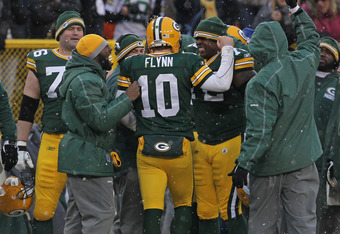GREEN BAY, WI - JANUARY 01:  Matt Flynn #10 of the Green Bay Packers is greeted by teammates and coaches after throwing the game-winning touchdown pass against the Detroit Lions at Lambeau Field on January 1, 2012 in Green Bay, Wisconsin. The Packers defe