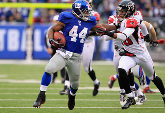 EAST RUTHERFORD, NJ - JANUARY 08:  Ahmad Bradshaw #44 of the New York Giants runs the ball against Thomas DeCoud #28 of the Atlanta Falcons during their NFC Wild Card Playoff game at MetLife Stadium on January 8, 2012 in East Rutherford, New Jersey.  (Pho