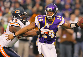 MINNEAPOLIS, MN - JANUARY 01:   Chauncey Davis #94 of the Chicago Bears gets the sack of Joe Webb #14 of the Minnesota Vikings at the Hubert H. Humphrey Metrodome on January 01, 2012 in Minneapolis, Minnesota.  (Photo by Adam Bettcher /Getty Images)