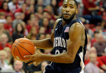 LAS VEGAS, NV - NOVEMBER 14:  Deonte Burton #24 of the Nevada Reno Wolf Pack drives against the UNLV Rebels during their game at the Thomas & Mack Center November 14, 2011 in Las Vegas, Nevada. UNLV won 71-67.  (Photo by Ethan Miller/Getty Images)
