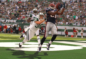 EAST RUTHERFORD, NJ - SEPTEMBER 19:  Jim Leonhard #36 of the New York Jets defends against Randy Moss #81 of the New England Patriots on September 19, 2010 at the New Meadowlands Stadium  in East Rutherford, New Jersey. There was no touchdown on the play.