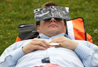 LONDON, ENGLAND - JUNE 20: A tennis fan takes a nap in the queue outside the All England Lawn Tennis and Croquet Club on Day One of the Wimbledon Lawn Tennis Championships at the All England Lawn Tennis and Croquet Club on June 20, 2011 in London, England