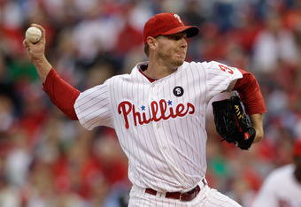 PHILADELPHIA, PA - OCTOBER 01:  Roy Halladay #34 of the Philadelphia Phillies throws a pitch in the first inning againt the St. Louis Cardinals during Game One of the National League Division Series at Citizens Bank Park on October 1, 2011 in Philadelphia