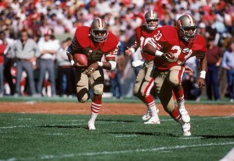 SAN FRANCISCO - SEPTEMBER 30:  Running back Wendell Tyler #26 of the San Francisco 49ers runs behind the protection of teammate running back Roger Craig #33 during a game against the Atlanta Falcons at Candlestick Park on September 30, 1984 in San Francis