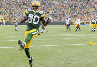GREEN BAY, WI - NOVEMBER 20:   Donald Driver #80 of the Green Bay Packers celebrates after  E.J. Biggers of the Tampa Bay Buccaneers is called for pass interference on November 20,2011 at Lambeau Field in Green Bay, Wisconsin.  (Photo by Elsa/Getty Images