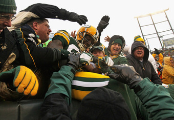 GREEN BAY, WI - JANUARY 01:  Donald Driver #80 of the Green Bay Packers jumps into the stands after scoring a touchdown against the Detroit Lions at Lambeau Field on January 1, 2012 in Green Bay, Wisconsin. The Packers defeated the Lions 45-41.  (Photo by