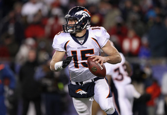 FOXBORO, MA - JANUARY 14:  Tim Tebow #15 of the Denver Broncos looks to pass against the New England Patriots during their AFC Divisional Playoff Game at Gillette Stadium on January 14, 2012 in Foxboro, Massachusetts.  (Photo by Elsa/Getty Images)